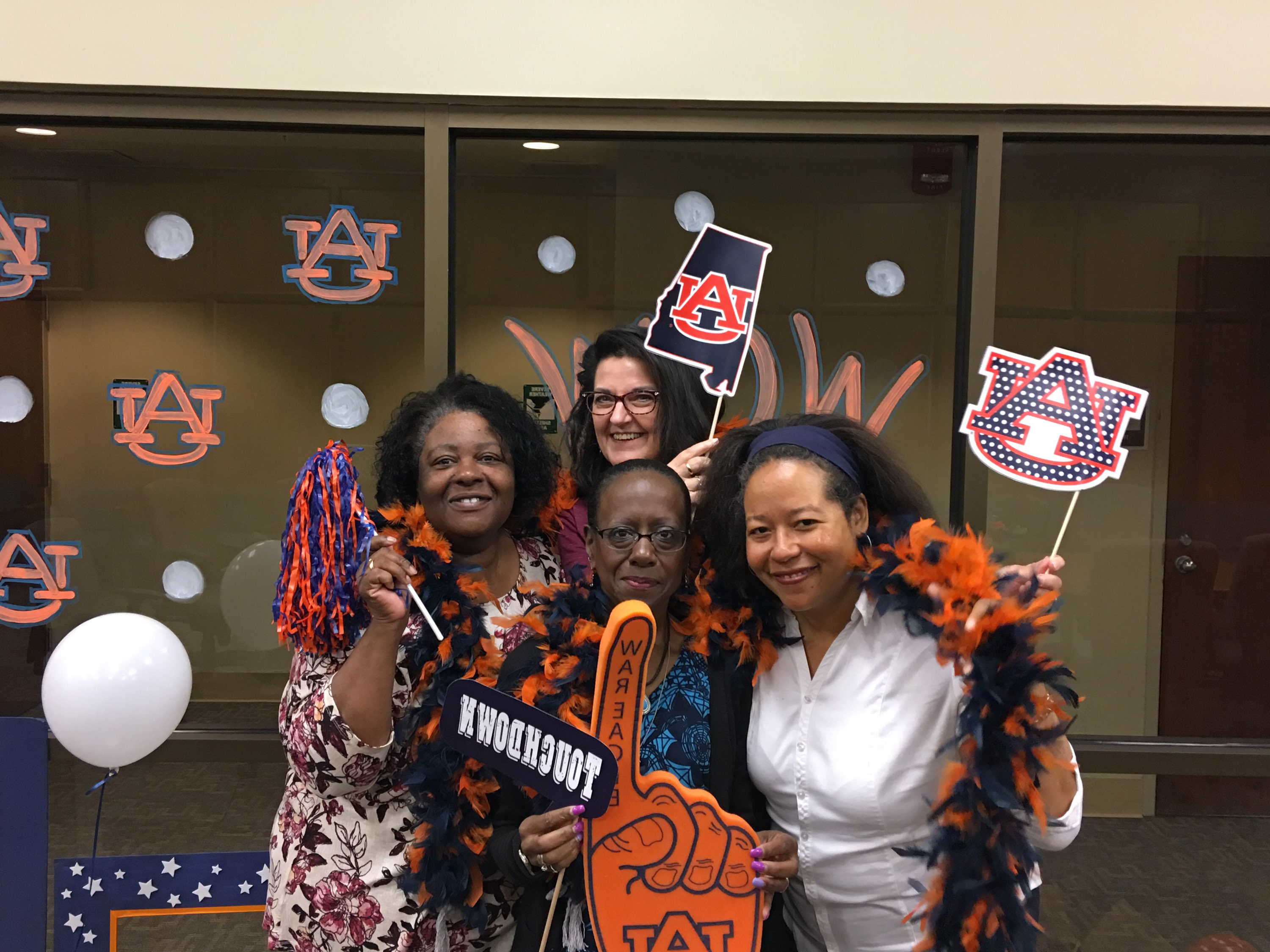 four women in Auburn apparel